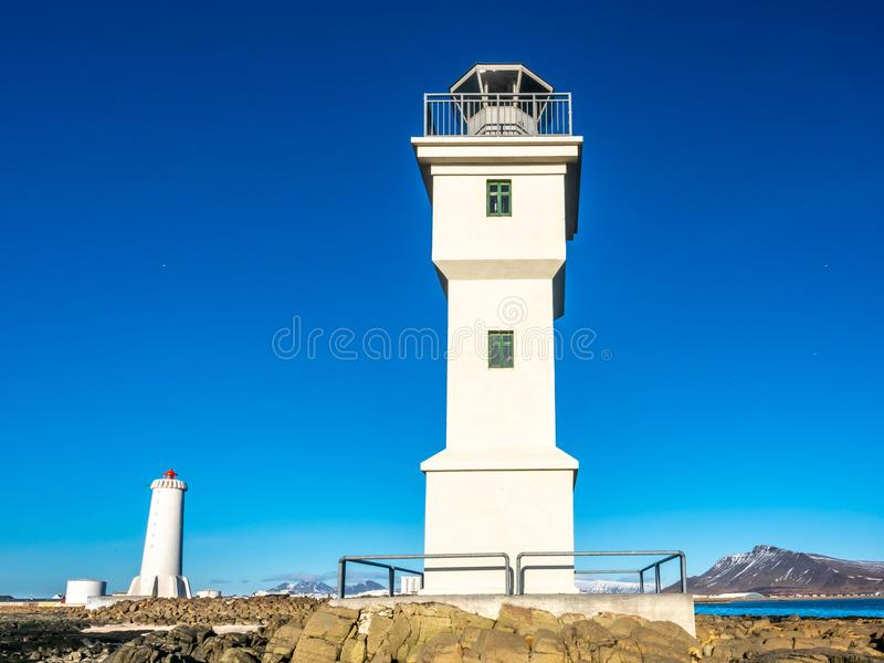 Old inactive Arkranes lighthouse, Iceland. The old inactive Arkranes lighthouse at end of peninsula, was built since 1918, under blue sky, Iceland royalty free stock photography