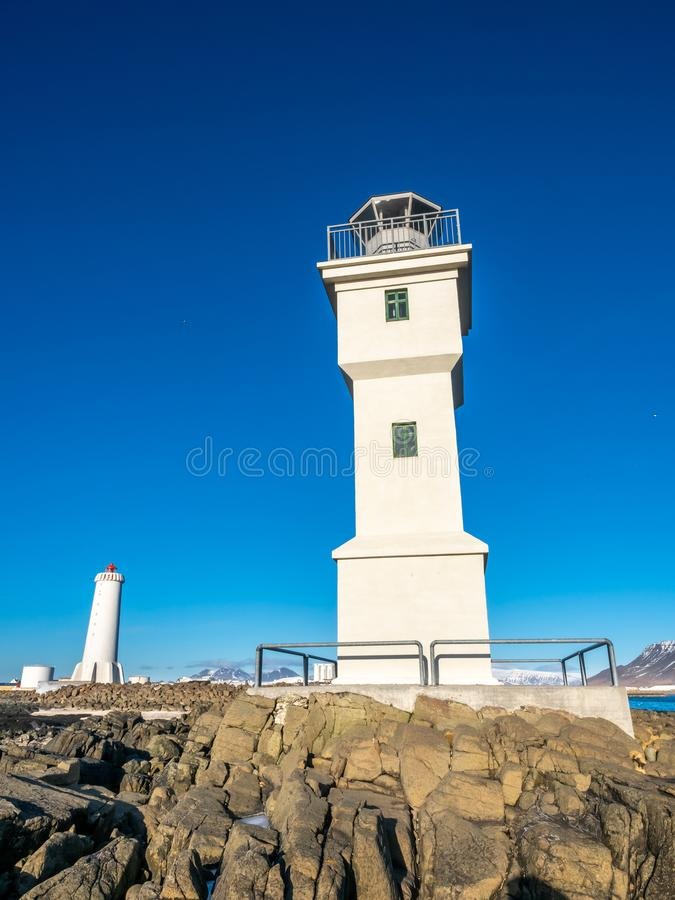 Old inactive Arkranes lighthouse, Iceland. The old inactive Arkranes lighthouse at end of peninsula, was built since 1918, under blue sky, Iceland royalty free stock photo