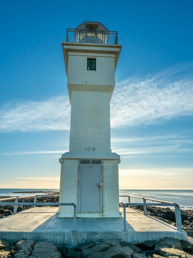 Old inactive Arkranes lighthouse, Iceland. The old inactive Arkranes lighthouse at end of peninsula, was built since 1918, under blue sky, Iceland stock photo