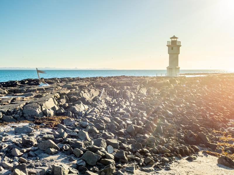 Old inactive Arkranes lighthouse, Iceland. The old inactive Arkranes lighthouse at end of peninsula, was built since 1918, under blue sky, Iceland royalty free stock photos