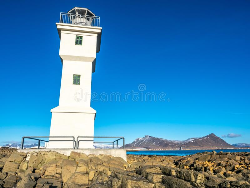 Old inactive Arkranes lighthouse, Iceland. The old inactive Arkranes lighthouse at end of peninsula, was built since 1918, under blue sky, Iceland stock images