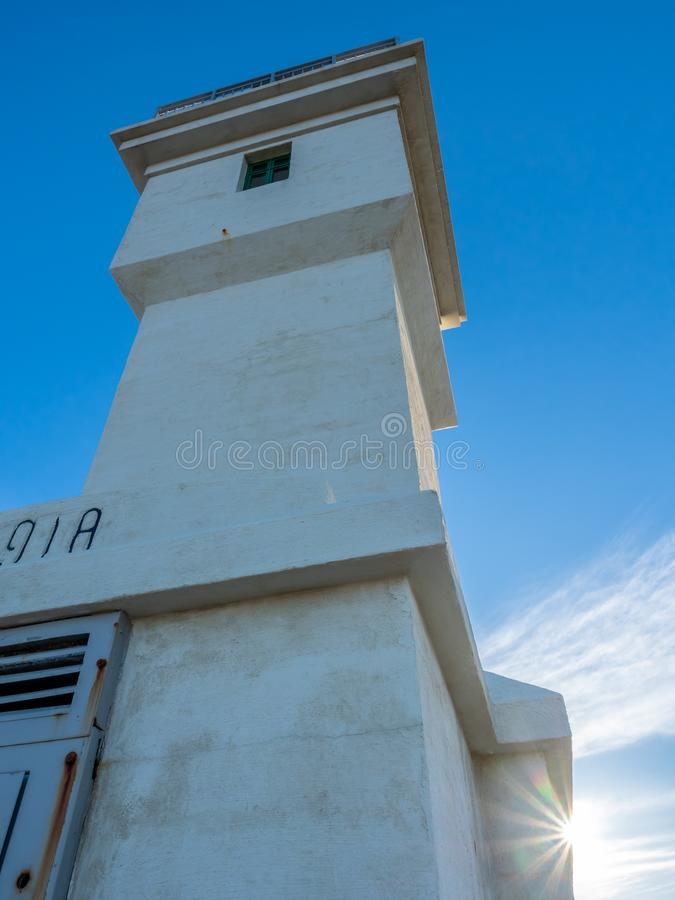 Old inactive Arkranes lighthouse, Iceland. The old inactive Arkranes lighthouse at end of peninsula, was built since 1918, under blue sky, Iceland royalty free stock image