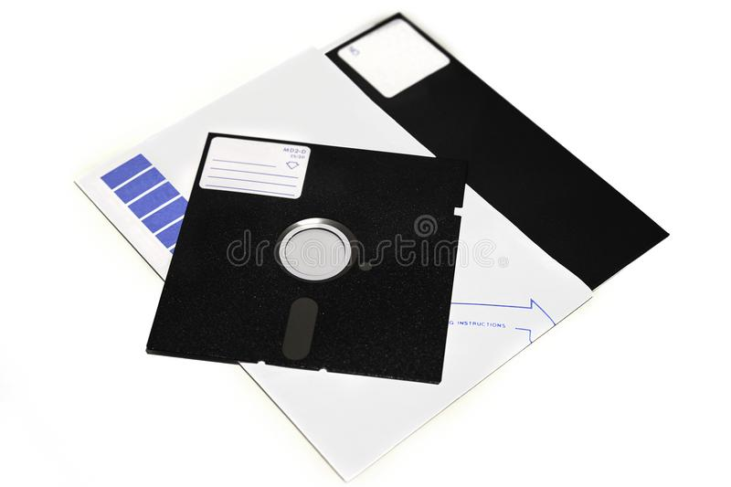Old 5.25 and 8 inch floppy disks isolated on white background stock photo