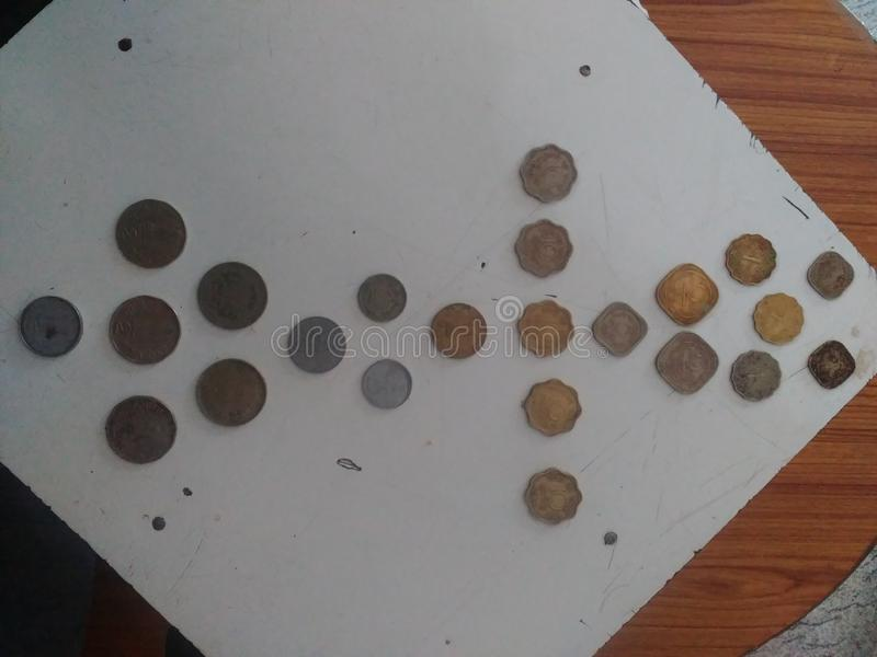 Old indian coins with dates and original royalty free stock images