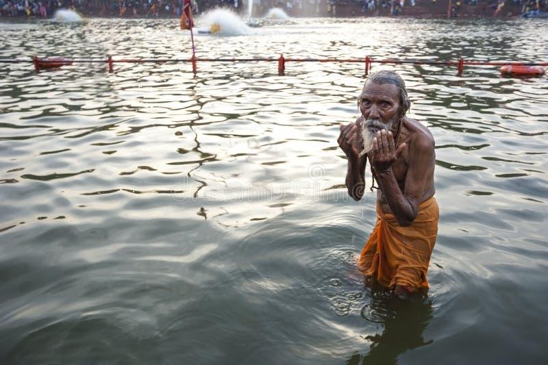 Old Indian Man Bathing stock image