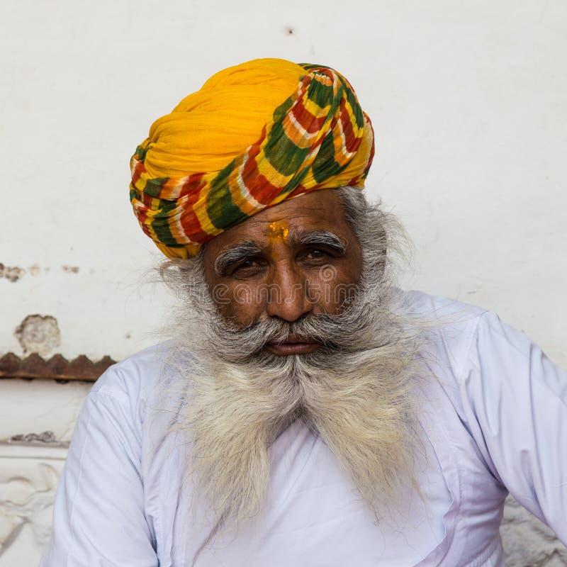 An old Indian man with a beautiful beard