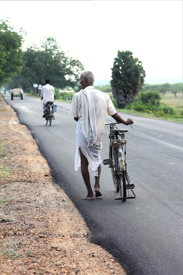 Old Indian man on foot