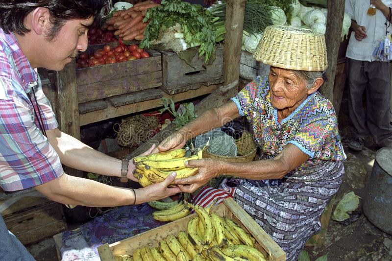Old Indian market woman sells fruit and vegetables. GUATEMALA, department Baja Verapaz, village Rabinal, Guatemalan Achi Maya Indian, elderly, market woman stock image
