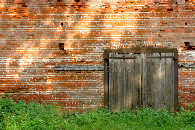 Old Industrial Brick Building With Wood Doors Stock Photo