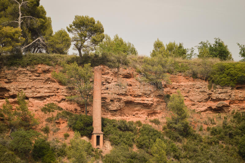 Old Industrial Chimney. Remains from the times of the industrial revolution. A chimney on a hill stock photos