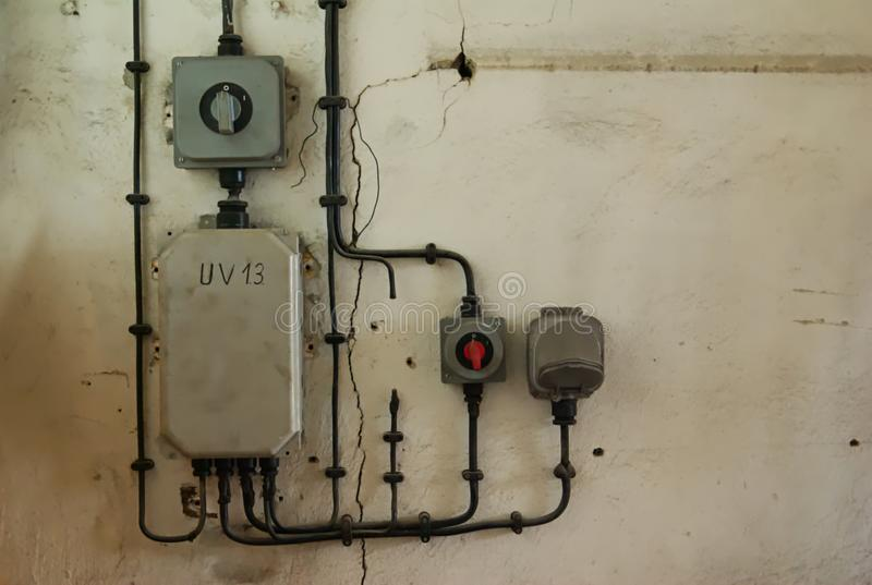 Old industrial electric plug, fuse box and switch on the vintage wall royalty free stock images