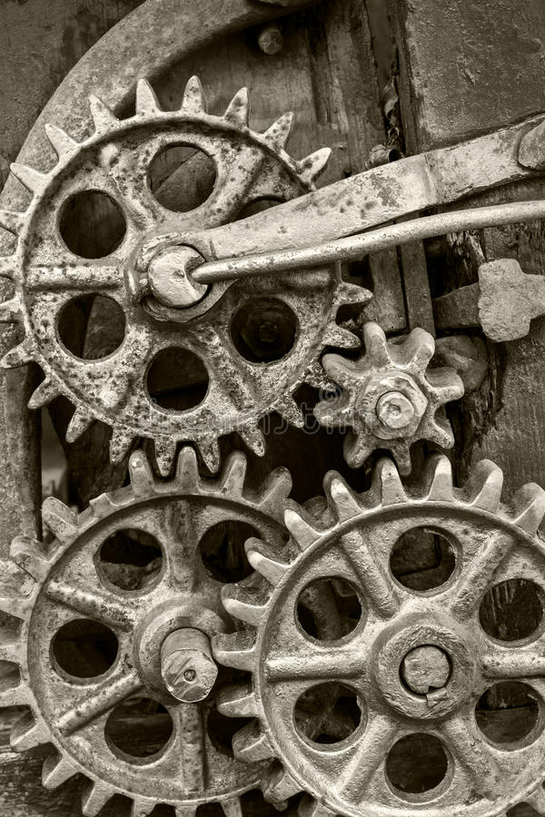 Old industrial mechanism with rusty gearwheels. Old dirty industrial mechanism with rusty gearwheels stock images