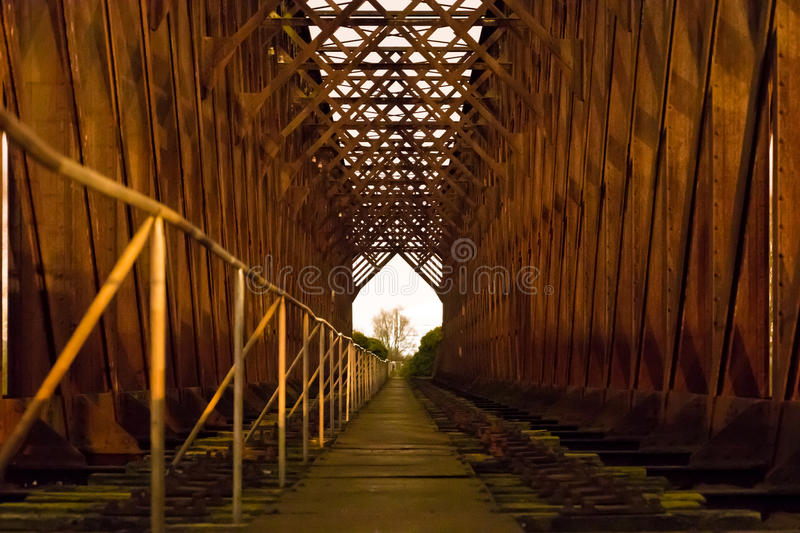 Old industrial railway railroad iron bridge center perspective n royalty free stock image