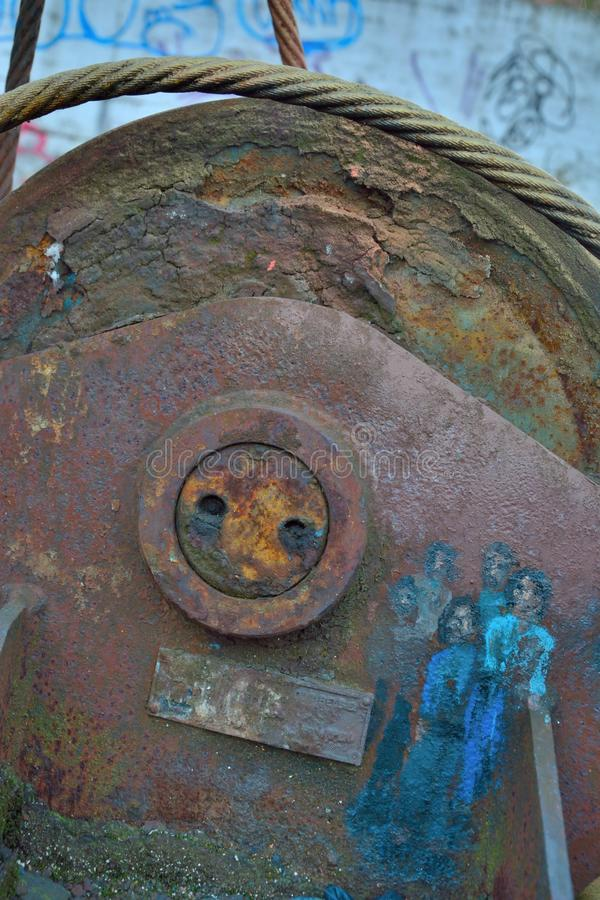 Old industrial rusted equipment with miniature painting, the blue people. Ghent, Belgium, March 2017: Old industrial rusted equipment with miniature painting royalty free stock photos