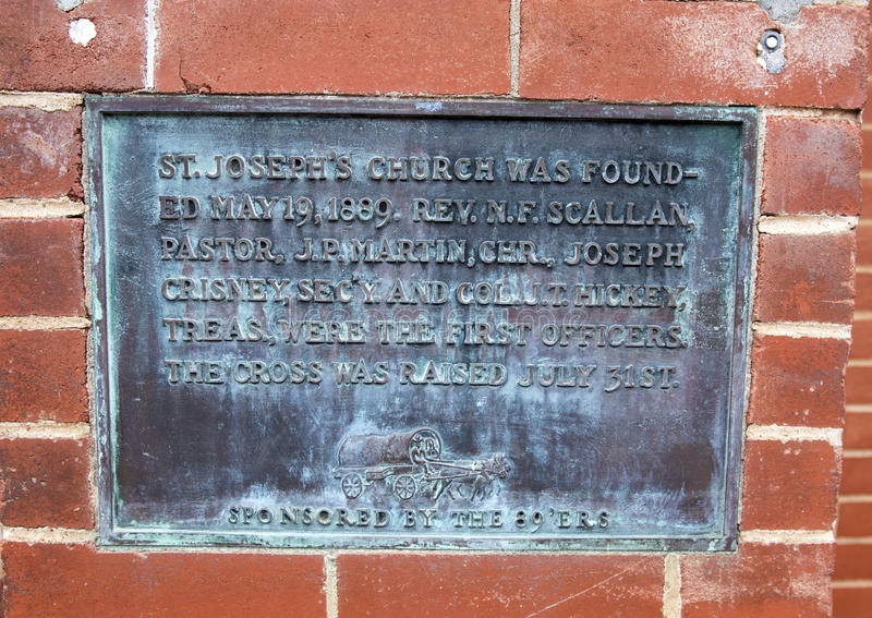 Old informative plate sponsored by the 89`ERS on St. Joseph`s Old Cathedral. Pictured is an old plaque from 1889 on the wall of St. Joseph`s Old Cathedral in royalty free stock images