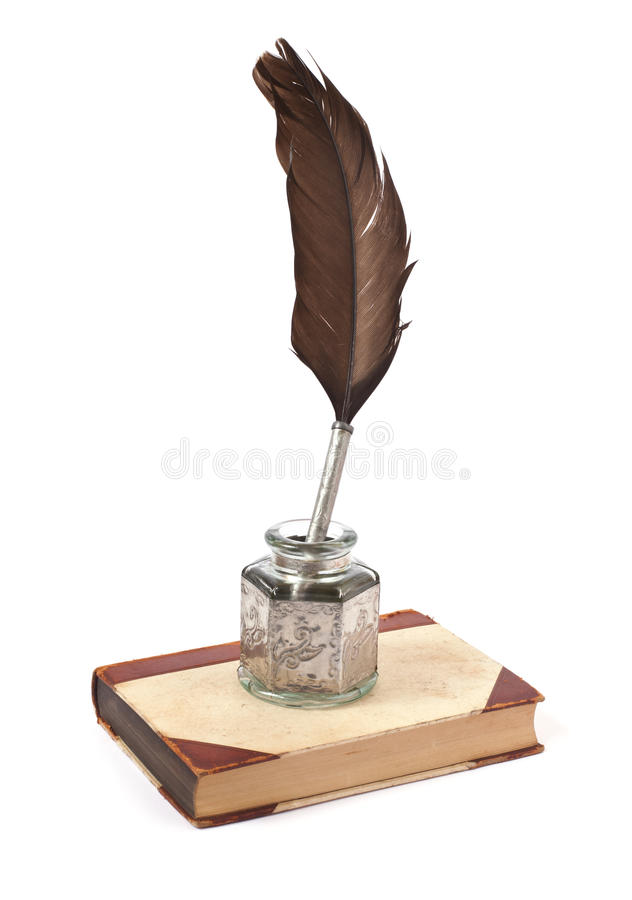 Old ink pen and book stock images