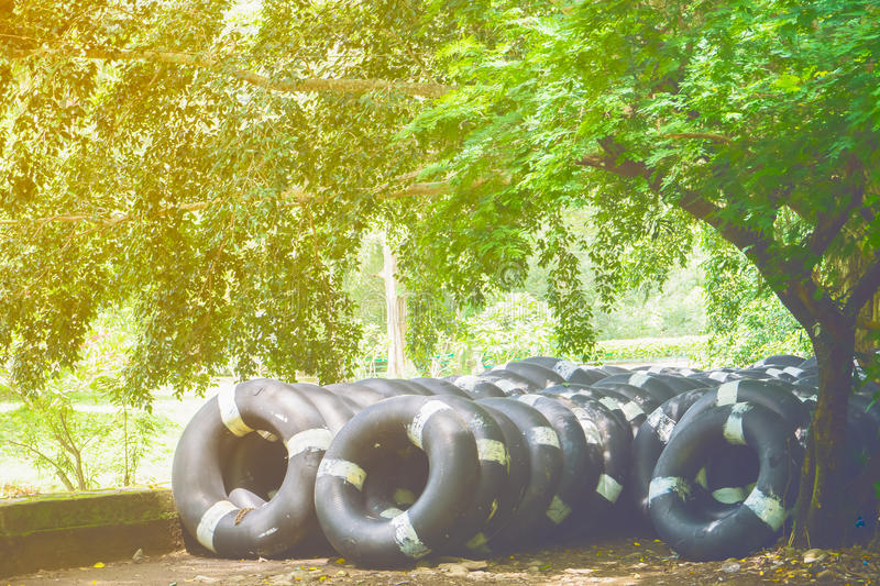 Old inner tubes floating, inner rubber tire royalty free stock photography