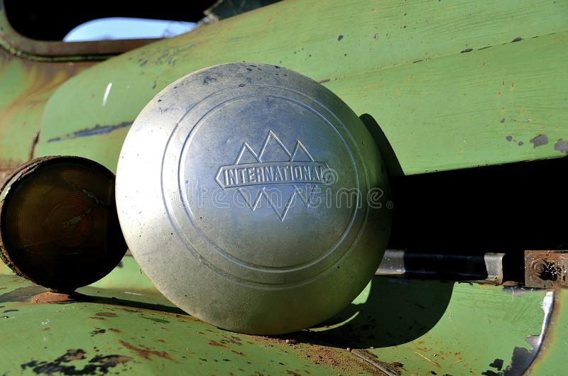 Old International pickup hubcap. MANDAN, NORTH DAKOTA, June 24, 2016: The old rusty International pickup hubcap is a product of the International Harvester stock photos
