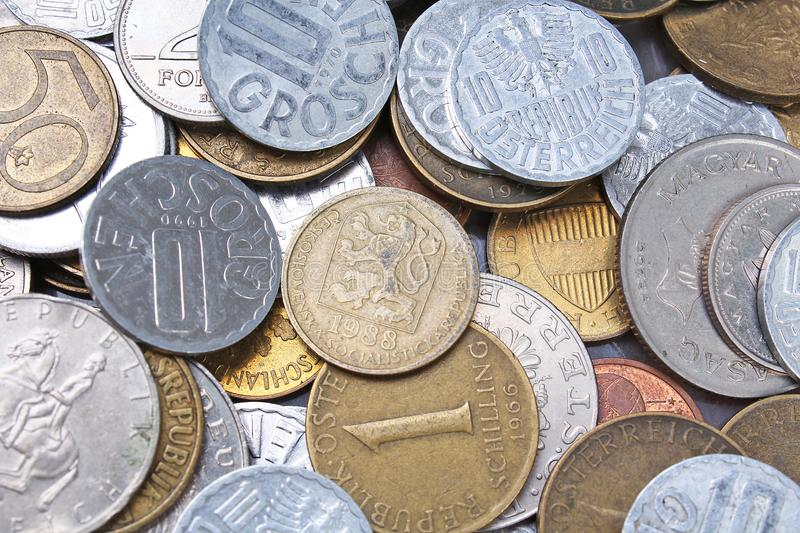 Old invalid coins from europe. History coins texture pattern Money coins background. Filler Schilling Groschen Pfennig stock photo