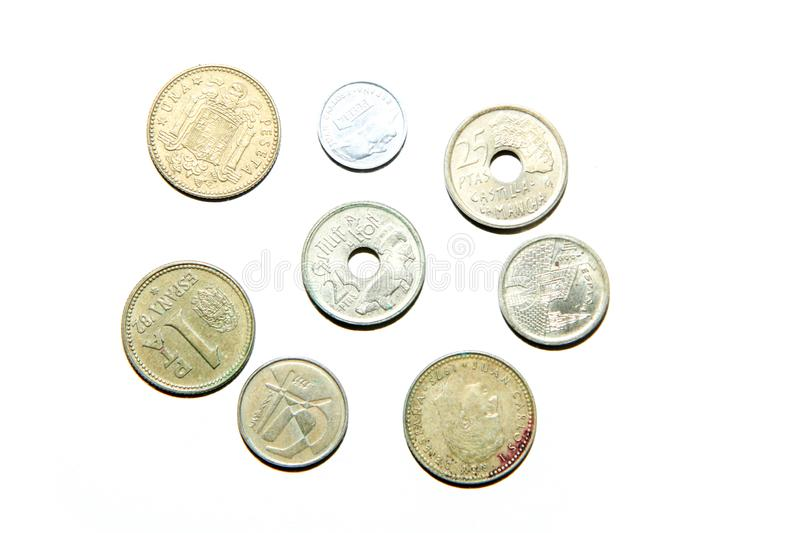 Old, invalid coins from Spain. Isolated on a white background stock photos