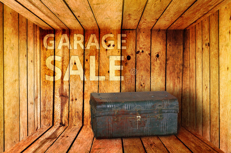 Old iron box and garage sale words on wood background royalty free stock photos