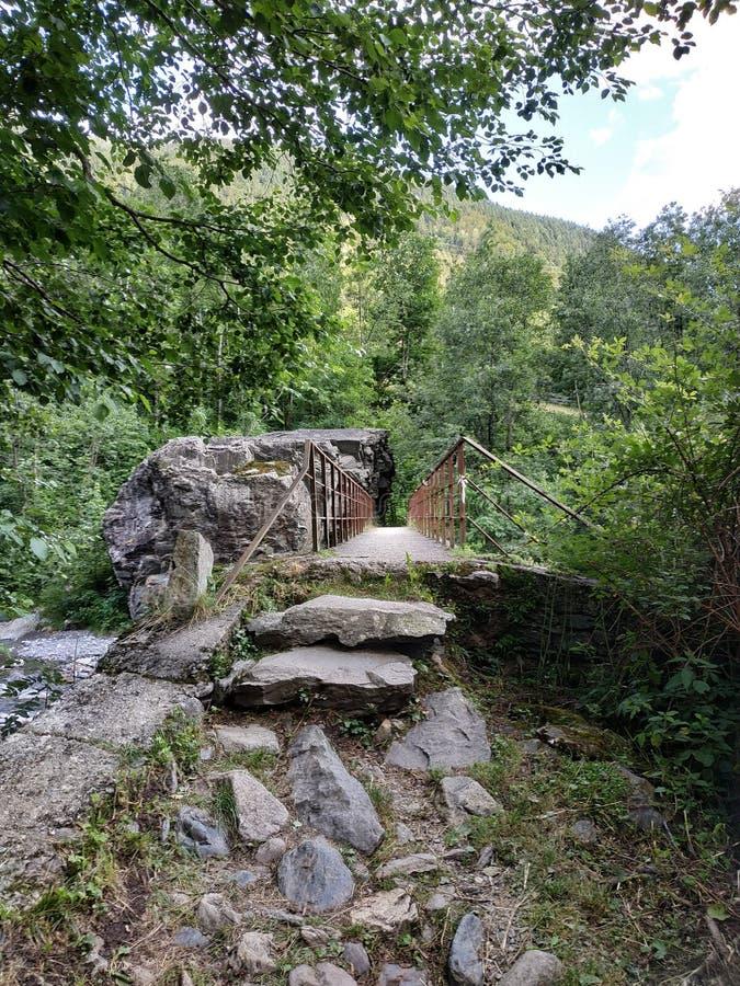 Old iron bridge entrance in orobie mountains. Old iron bridge entrance in orobie royalty free stock photo