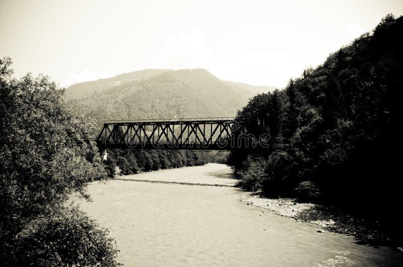 The old iron bridge over the river stock photos