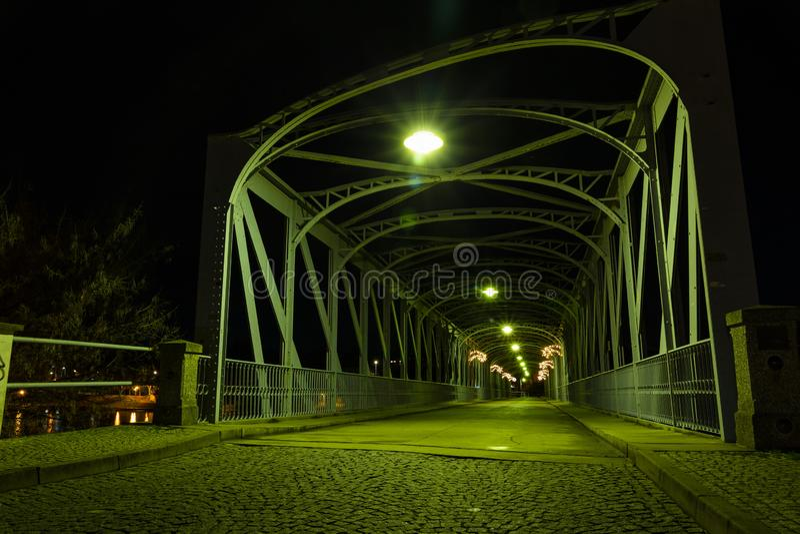 Old iron Bridge over Vltava river in Tyn nad Vltavou, Czech Republic stock images