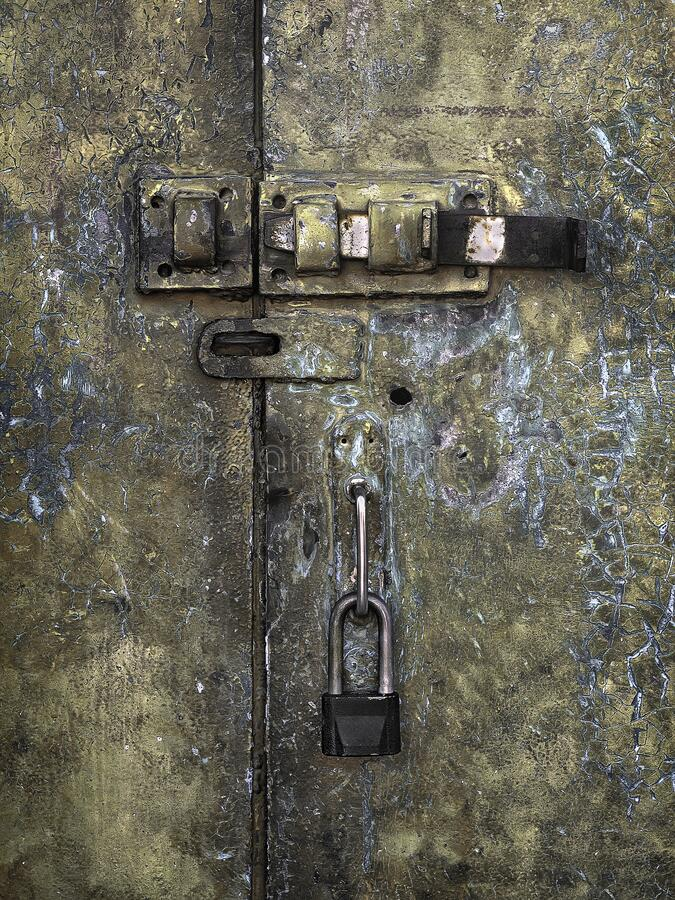 Old iron door with a lock and hasp stock photos