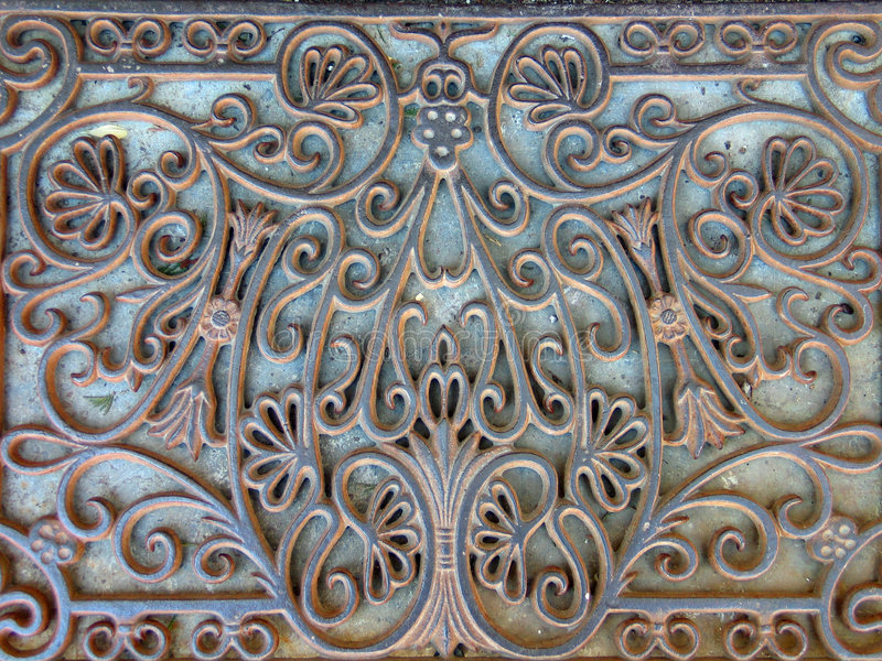 Old iron doormat. Ornate antique doormat made of cast iron royalty free stock photography