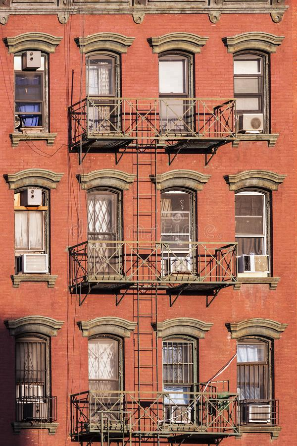 Old iron fire escape rescue ladders at old houses royalty free stock photos