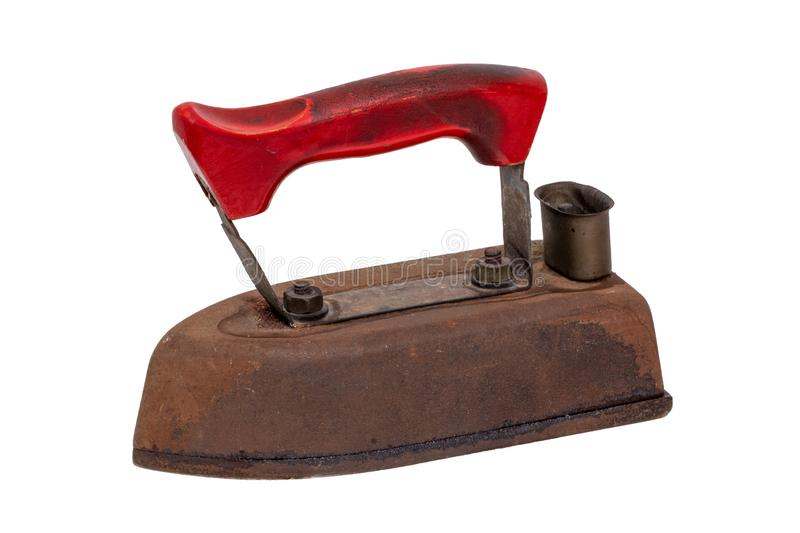 Old iron isolated. Close-up of a professional old rusty electric tailor iron or flatiron with a red handle isolated on a white stock photos