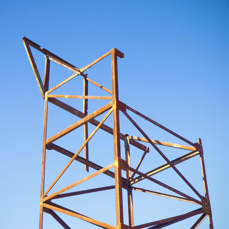 Old iron structure on blue background royalty free stock photos