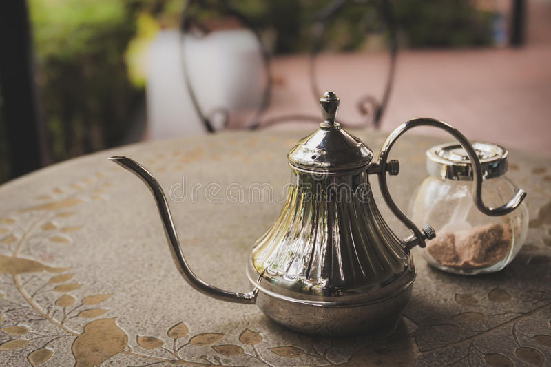 Old iron tea pot with sugar on the table. Old iron tea pot with sugar on table stock photography
