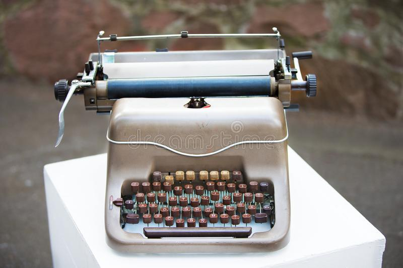 Typewriter. An old iron typewriter of small size with a wooden keyboard. Retro keyboard royalty free stock photos
