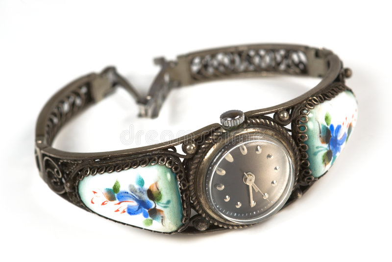Old iron wrist watch. Old time style iron wrist watch with enamel stock images