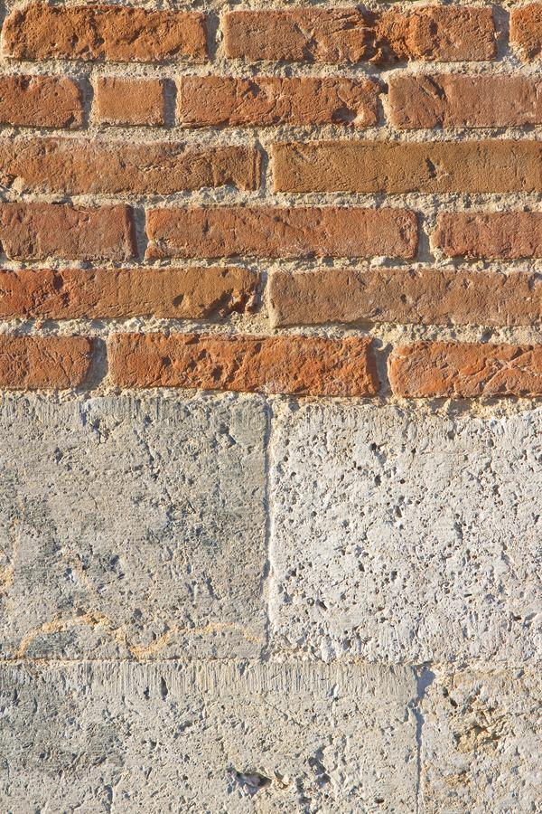 Old italian brick and bright stone wall after an architectural r stock photography