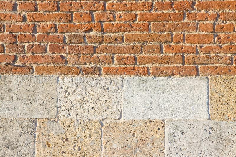Old italian brick and bright stone wall after an architectural restoration Italy-Tuscany region stock image