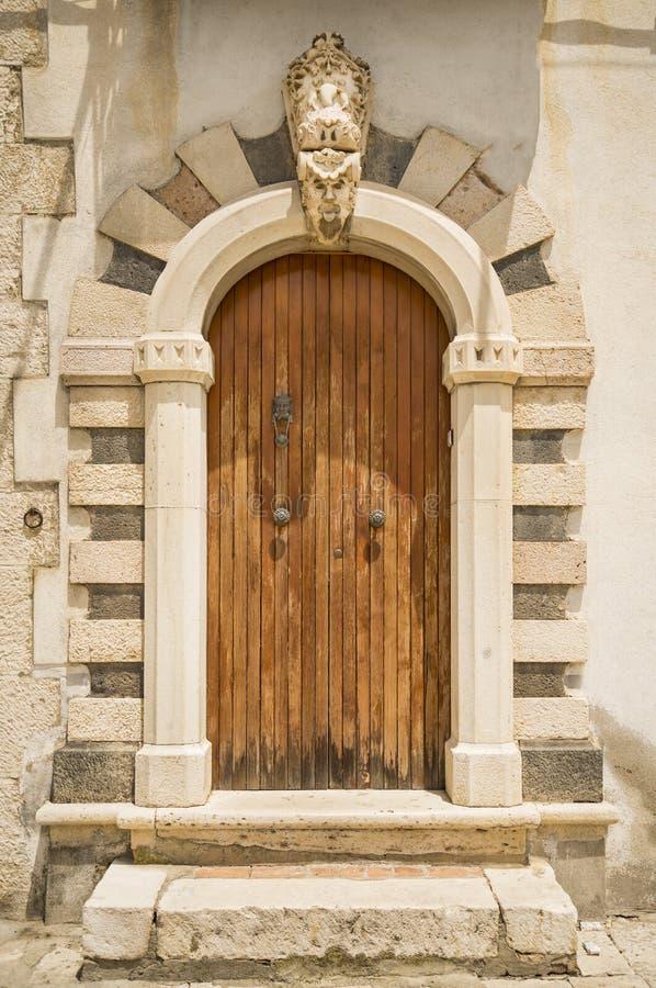 Old Italian door. The entrance wooden door in an old Italian house stock image