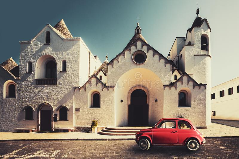 Old vintage italian scene. Small antique red car. Fiat 500 royalty free stock images