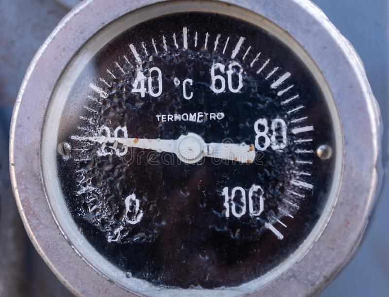 Old italian industrial thermometer. Temperature indicator showing degrees Celsius, symbolically an alteration of the global average temperature and increase in royalty free stock photo
