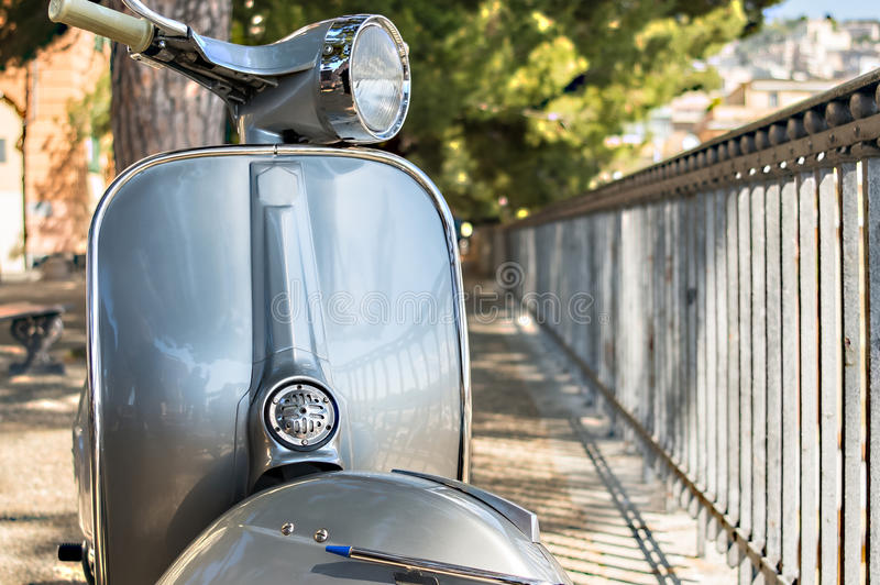 Old Italian scooter on a viewpoint of the city of Genoa, Italy royalty free stock image