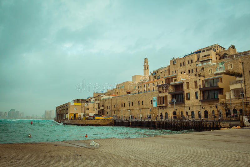 Old Jaffa on a cloudy day. View of old Jaffa on a cloudy day. Tel Aviv in the background stock photos