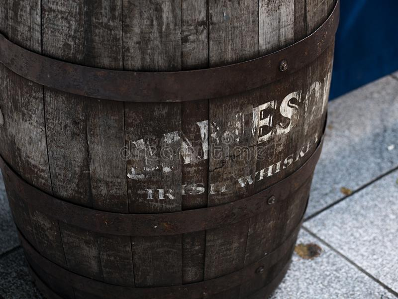 Old Jameson Irish Whisky barrel in Dublin, Ireland. Close up / detail of Old wooden Jameson Irish Whisky barrel in Dublin, Ireland, outside an Irish pub in stock photography