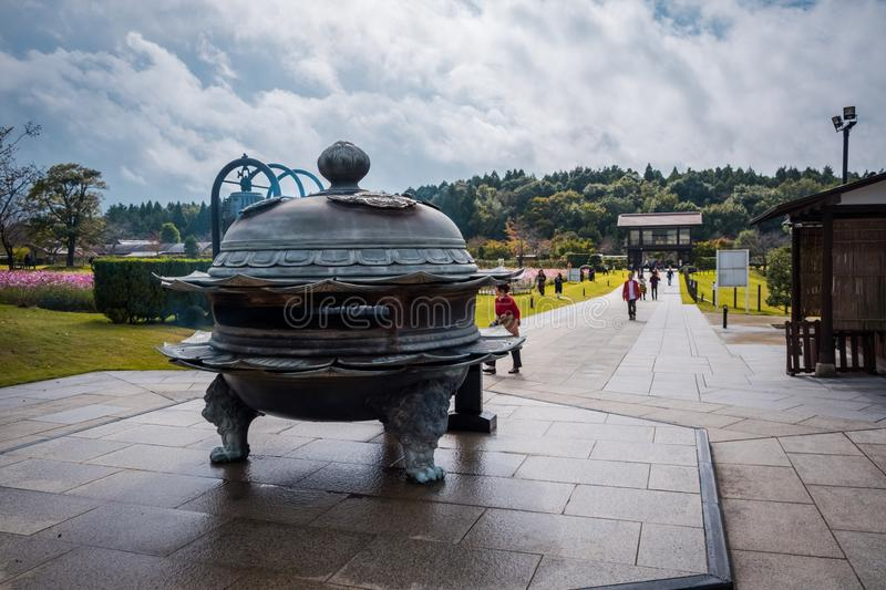 The old-Japanese style incense burner for praying to Ushiku Daibutsu, is the largest Buddha statue in the world, Japan. stock photos