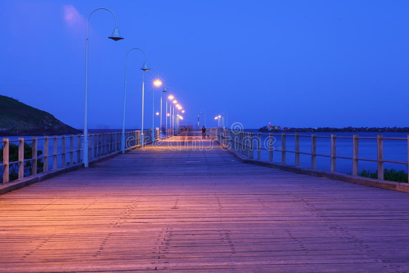 Jetty promenade summer night blur stock photography