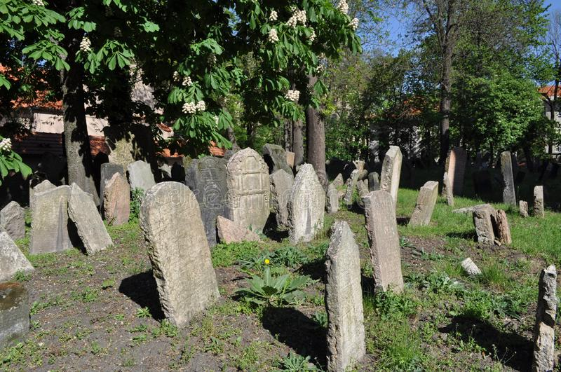 Old Jewish cemetery, Prague. It was founded at the beginning of the 15th. When it stopped using it in 1787, there was no more room. It has 12,000 graves in an stock image