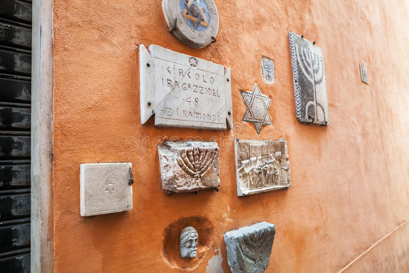 Old Jewish symbols in ghetto of Rome royalty free stock photo