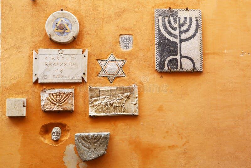 Old Jewish symbols in ghetto of Rome stock photos