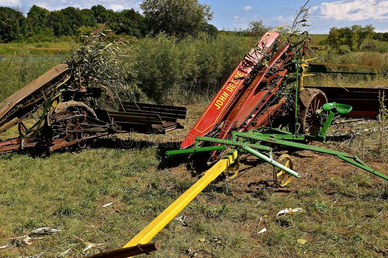 Old John Deere horse pulled corn picker. ROLLAG, MINNESOTA, Sept 2. 2017: An old John Deere horse pulled corn picker is displayed at the annual WCSTR farm show stock image